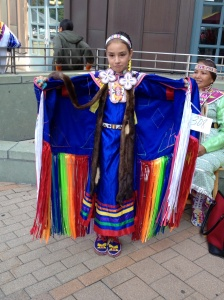 Beautiful young Native American girl spinning and practicing her dance number.